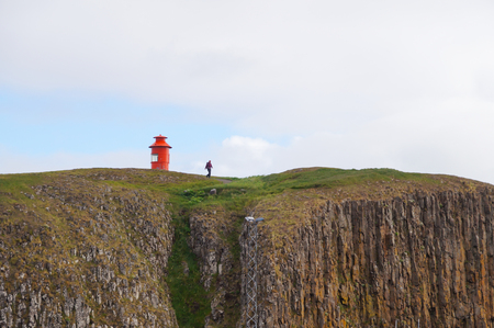 Snaefellsnes peninsula,Iceland- 27 June 2017: Unidentified tourist walking down from cliff in the town of Stykkisholmur, Snaefellsnes peninsula, the western part of Iceland