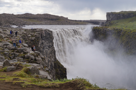 Dettifoss,Iceland- 30 June 2017: Unidentified tourists taking pictures at Dettifoss in summer, Iceland.