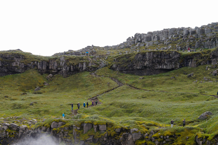 Dettifoss,Iceland- 30 June 2017: Unidentified tourists walking back from visiting Dettifoss in summer, Iceland.