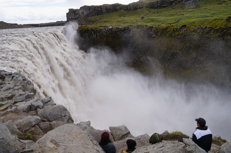 Dettifoss,Iceland- 30 June 2017: Unidentified tourists watching Dettifoss closely in summer, Iceland. Editorial