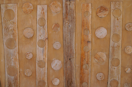 Round wood piece sticked on the wall for decorate in Thailand. Stock Photo