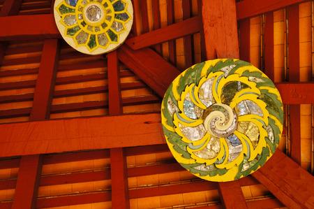Detail of ceiling at Wat Pong Sanuk Temples pavilion,Lampang,Thailand.