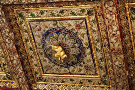Lovely cupid at ceiling of  Wat Phra Kaew Don Tao, Lampang, Northern Thailand.