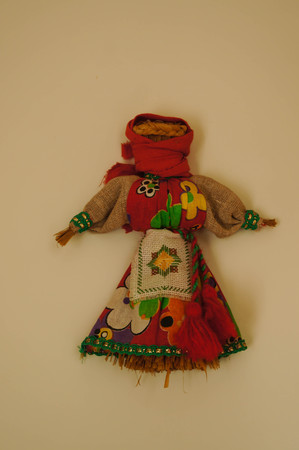 Cute doll in front of the rest room in Altai Republic,Russia.