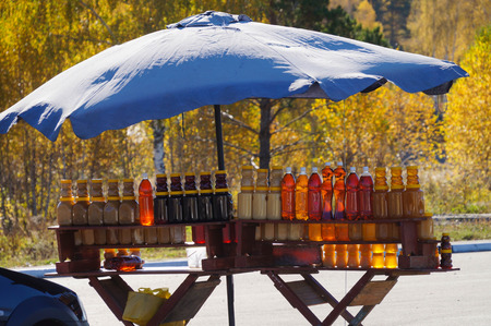 Bottles of honey for sale in autumn,Altai Repulic,Russia. Stock Photo