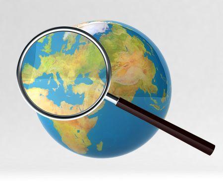 拡大鏡の下で地球 写真素材