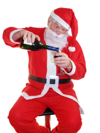 Santa having a well earned drink        Stock Photo