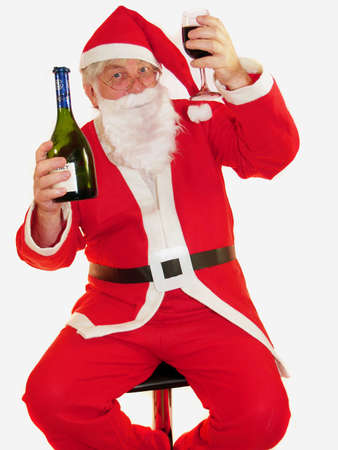 Santa toasting everyone at christmas         Stock Photo
