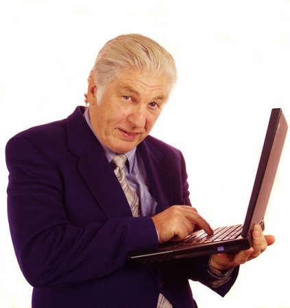 Senior person communicating through his laptop computer Stock Photo - 587428