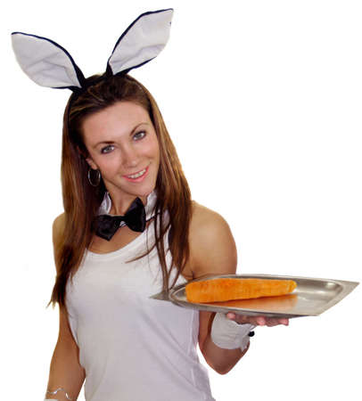 Easter bunny girl serving you a carrot very healthy photo