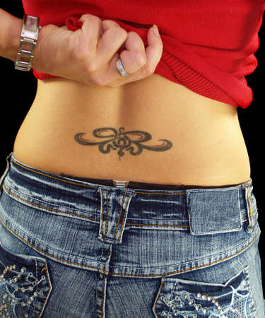 nice butt: Very artistic back showing her tattoo art Stock Photo