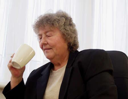 Having a coffee break older female worker         Stock Photo - 808330