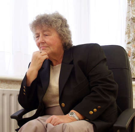 Lost in thought senior female in office