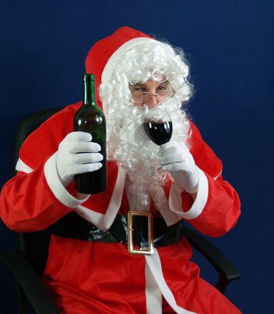 Santa drinking everyones health at Christmas