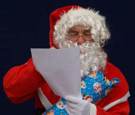 addresses: Santa reading a list of names  and addresses