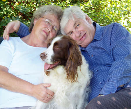 Couple and their dog english spaniel having a cuddle Stock Photo - 1537424