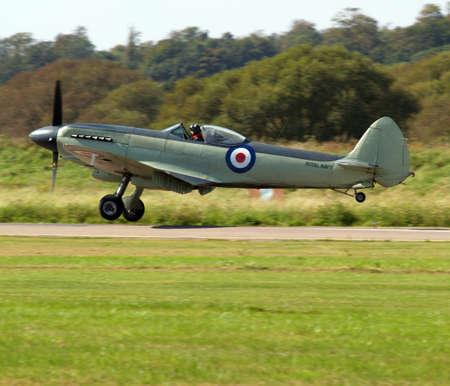 Fighter plane landing historic world war propeller driven        photo