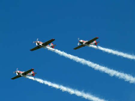 exiting: Stunt team at airshow Teamwork displaying brilliantly
