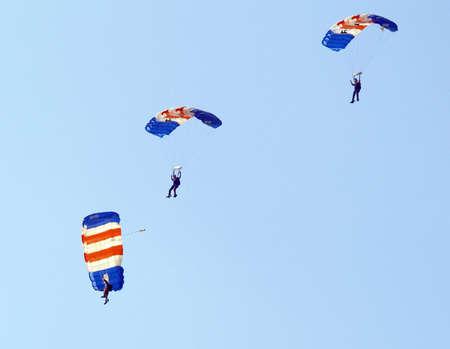 parachutists: Three parachutists landing at an  airshow