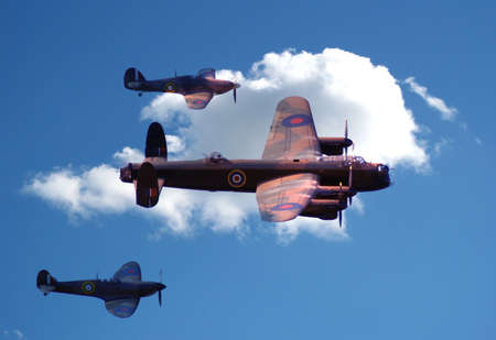 Bomber and fighter patrol the skies in formation