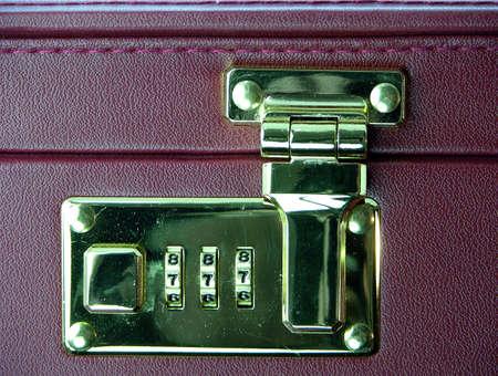 saddlebag: Combination lock on a case of a businessman
