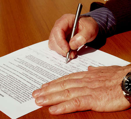 Signing the Contract  a businessman on a table