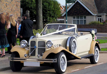 Vintage car waiting at the wedding with ribbons   Stock Photo