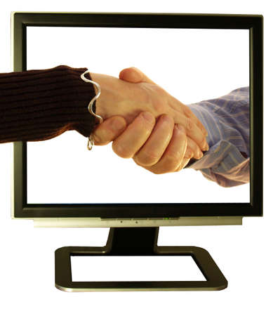 Making friends use your pc and shake hands Stock Photo