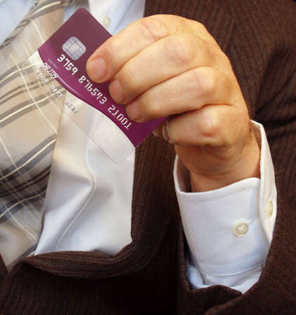 Credit card being waved in a gentle manner Stock Photo - 2309870