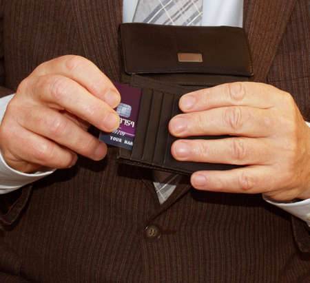 Fast on the drawer businessman opening his wallet       Stock Photo - 2309871