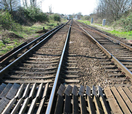 railtrack: Close-up of railtrack with distant station light Stock Photo