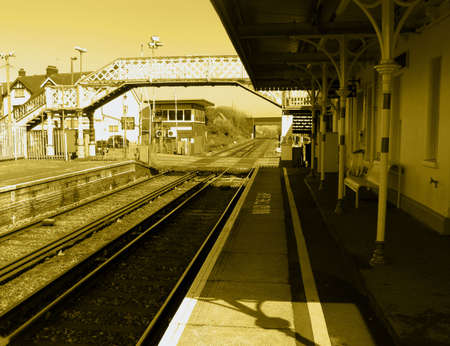 Traditional railway station with footbridge in sun Stock Photo - 2958677