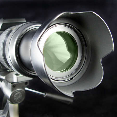 Camera lens on a tripod showing telephoto lens