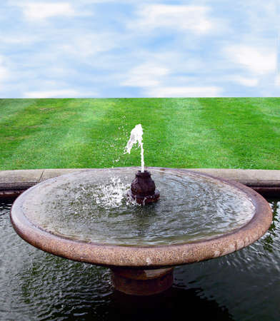 Background with fountain and water in front photo