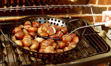 Chestnuts roasting on an open fire.... well Barbe          Stock Photo