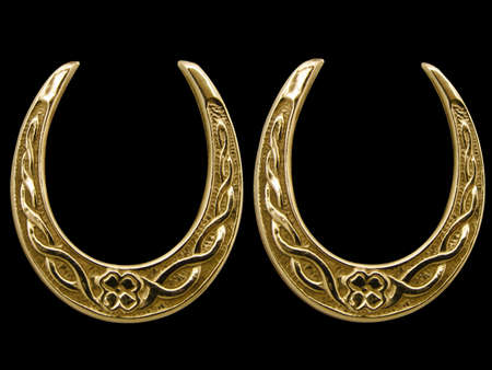 Antique lucky horse shoes in beaten gold          Stock Photo - 3971025