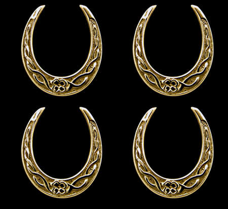 Antique lucky horse shoes in beaten gold          Stock Photo