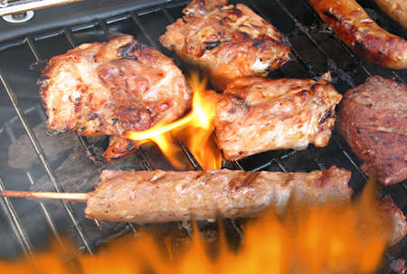 Smokey and firey barbecue sure sign of summer Stock Photo