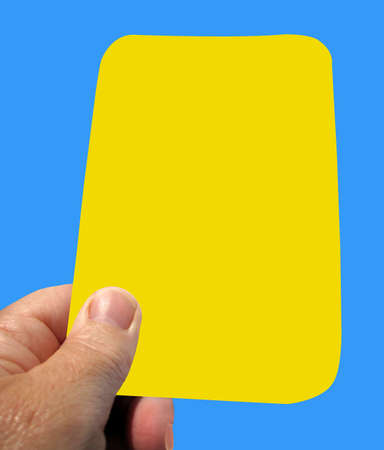 Yellow card for a warning two of these and you are sent off. Stock Photo - 5542041
