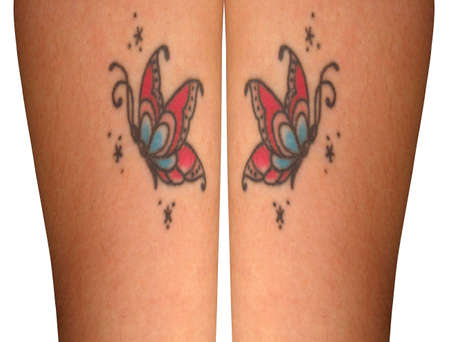 Butterrfly tattoos on a beauyiful pair of legs photo