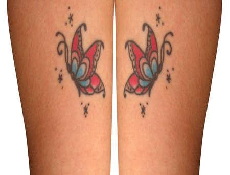 waxed legs: Butterrfly tattoos on a beauyiful pair of legs