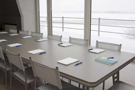 White notebooks laying on a grey table for negotions Stock Photo