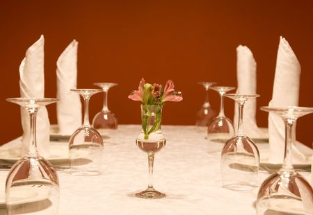 Utensils - wine-glasses and plates on a table Stock Photo