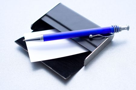 Pen laying on a case for cards Stock Photo