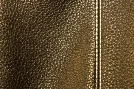 leather background stitched up by white thread