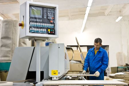 Operating working with wood paneling machine
