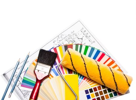 painter roller, pencils, drawings, paint brush  and color guide on white