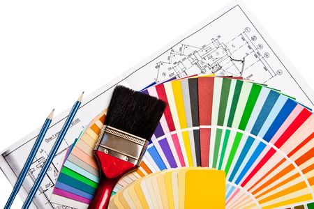 paint brush, pencils, drawings  and color guide on white