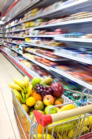 Grocery cart filled with fruits and vegetables