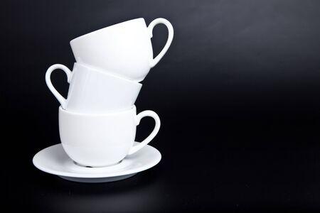 Three cups of white on a black background Stock Photo